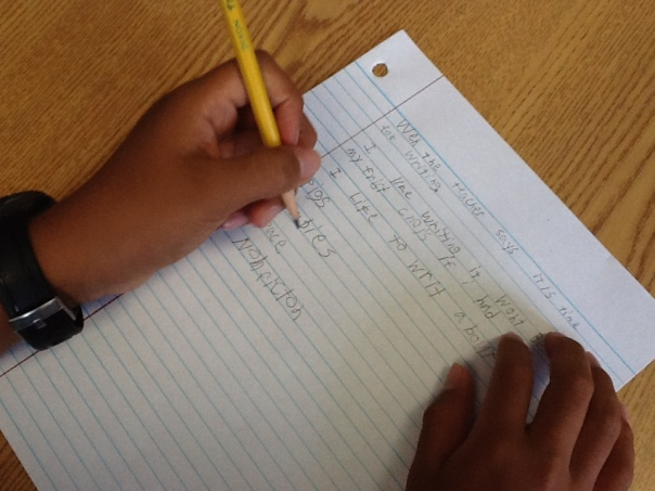 A photo of a fifth grader answering questions about what he likes and dislikes about writing.