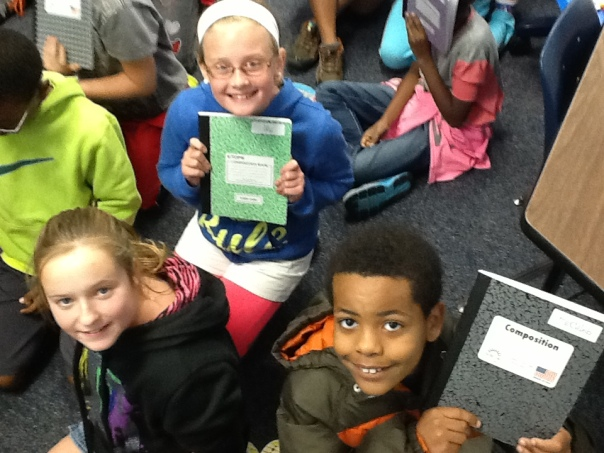 Happy fifth graders . . . after receiving their Writer's Notebooks!