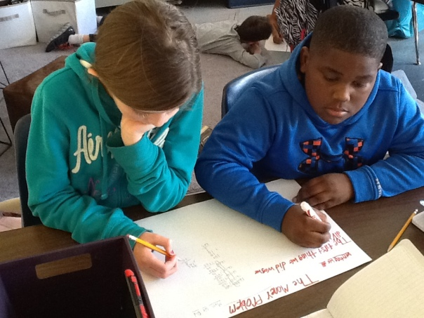 I love this photo because you can see how hard Chris and Zoe were working on their math poster.  Plus, they are truly a team!  Awesome.