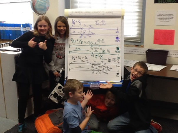 Our happy mathematicians couldn't resist posing with our double number line!