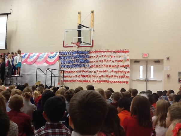 Check out this flag in the gym.  Your fifth grader is in there somewhere!