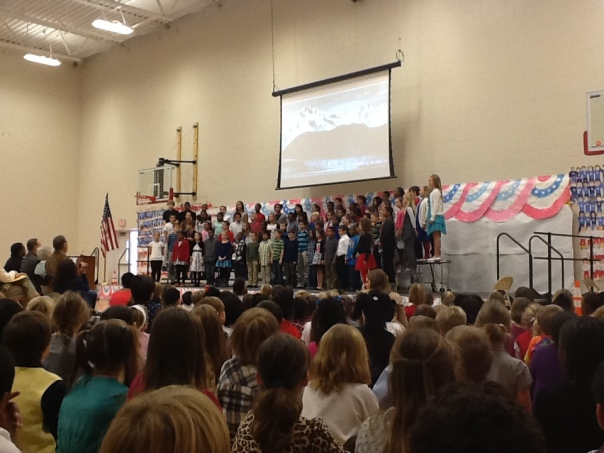 Here are the fifth graders performing for the school!  What great role models!