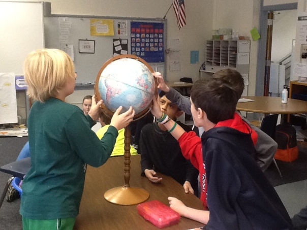 Look at how this group was using a globe to locate information about the question about the geography of West Africa.  I loved how engaged this group was in this photo!