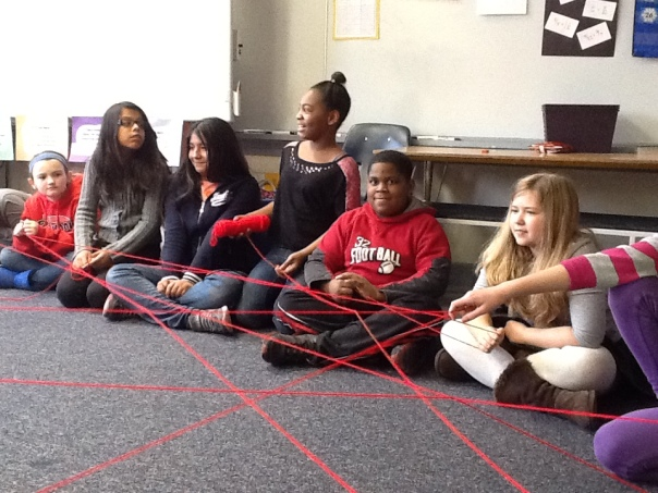 In our classroom, we sat in a circle discussing kind things others had done for us or kind things we had done for others.  After sharing, we passed the yarn to another student and created a really cool kindness web!