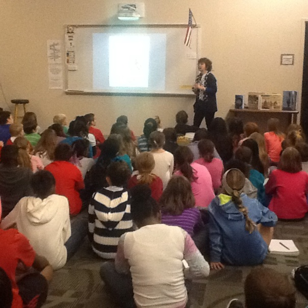 Here is Ms. Hopkinson talking to the fourth and fifth graders and Robinson.