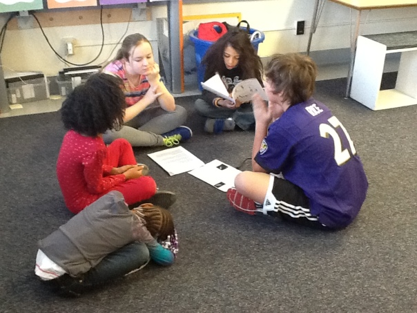 Another group of fifth grader sharing . . . even if some young kiddos look at little tired as they listen! :)