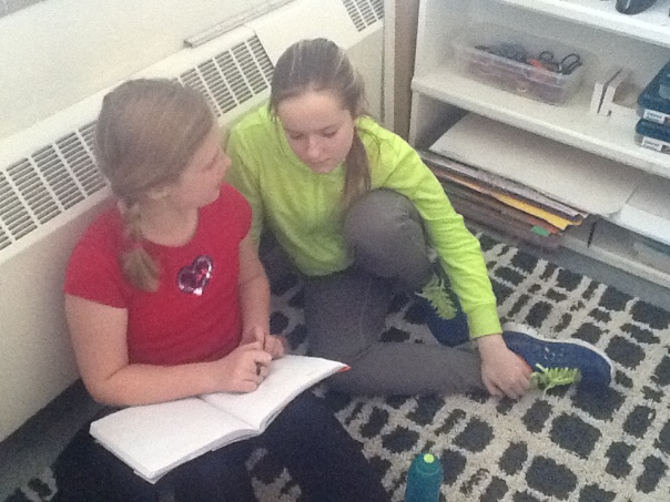 Morgan and Lilly were discussing the possibilities of a thesis statement from the story, Spaghetti.