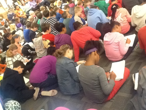 Look at all of these authors writing in their notebooks during the author visit!  They are so great!