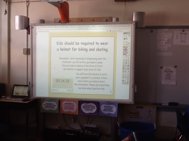 Here was the prompt we used to write our post-assessment.  We also use a timer, which you can see in this photo too.