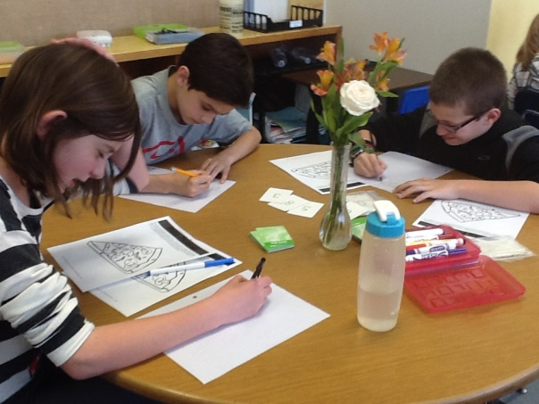Hard working mathematicians trying to quickly find the quotient for their game!
