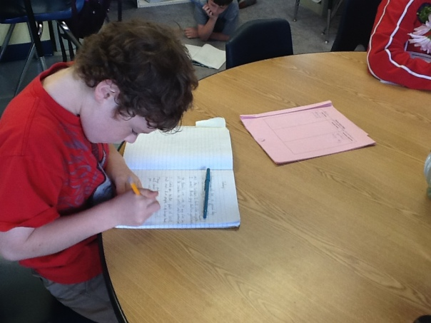 Another hard-working poet using his Poetry Word Bank to find precise words for his writing.