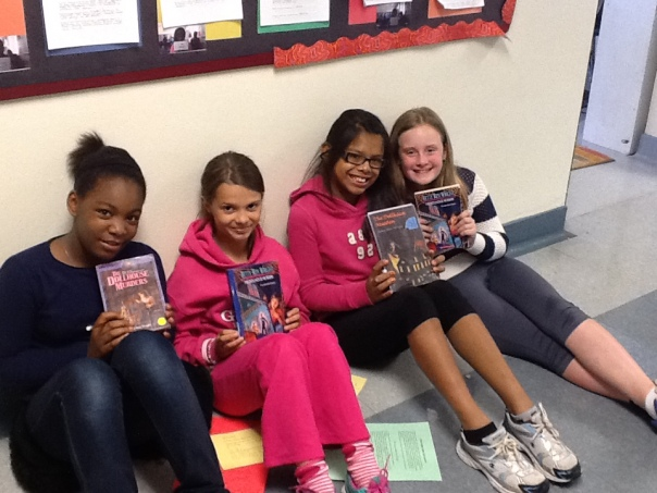 Look at these happy readers during their book club meeting!  It is so much fun when a book can be discussed among several readers.