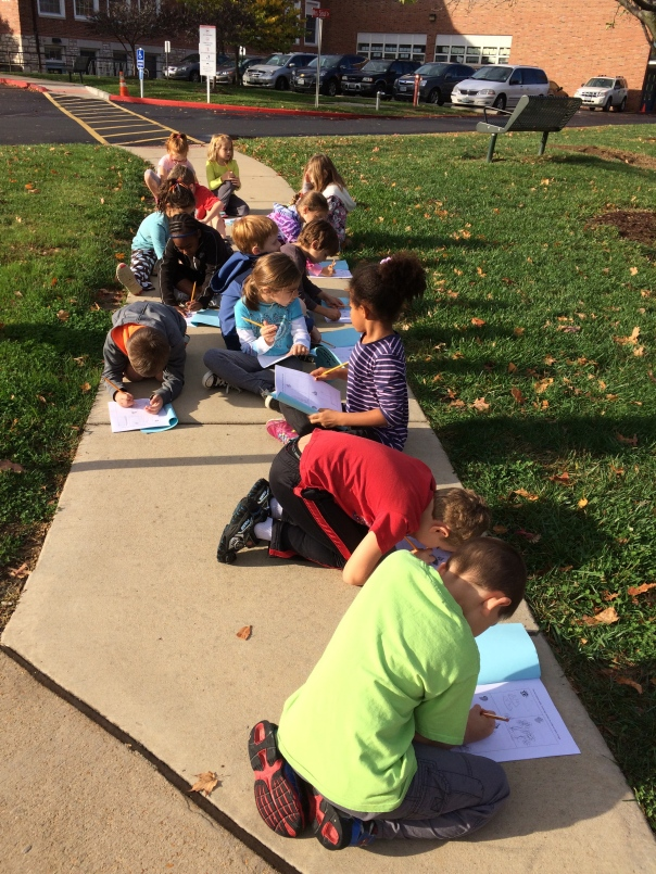 Check out these scientists writing down observations about what they saw, heard, smelled and felt during our time outside.