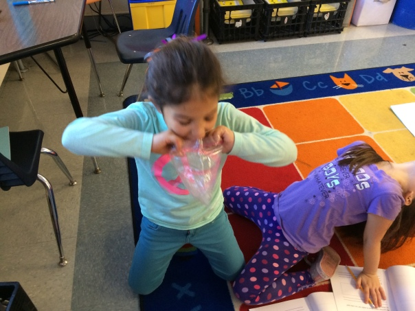 Check out Solis using the strategy of blowing into her bag to try and make her ice cube melt!