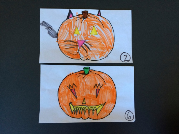 After voting, we had a tie between these two pumpkin designs.