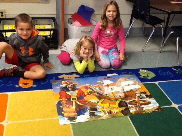 Look at these happy first graders after finishing their 100-piece puzzle!