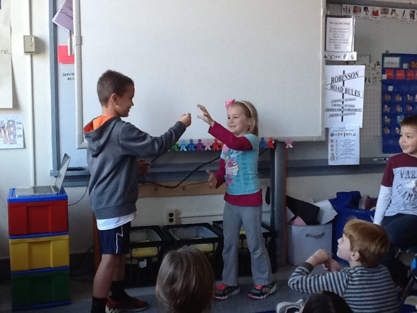 After voting a second time, there was STILL a tie!  The children decided to have the two artists (Maddie and Quinn) play a game of Rock, Paper, Scissors to decide whose design we should carve on our pumpkins.  What an official way to solve our problem, huh? :)