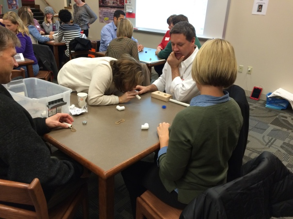Look at how hard these parents worked during the design challenge!