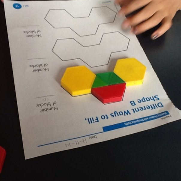 Students used pattern blocks to fill in the shapes.  The goal was to use different combinations of pattern blocks as they worked.