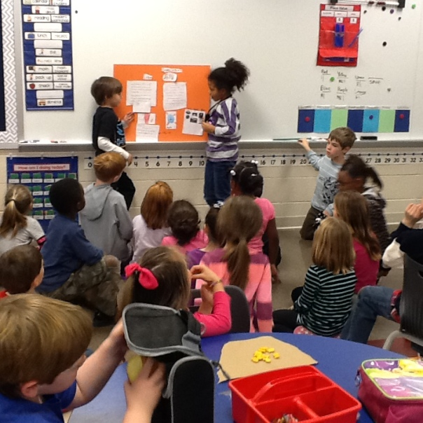 First grade scientists presenting to kindergartners.