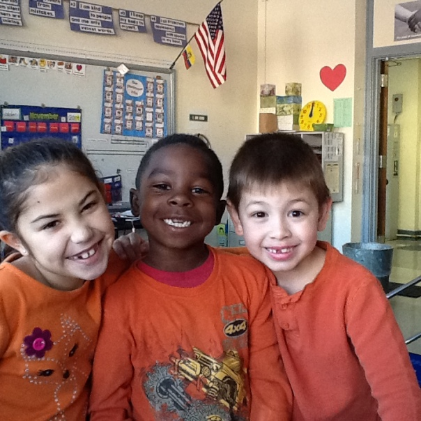 One day, all three of these children happened to wear orange shirts.  We thought it was cute so I took a picture of them!. SMILE!