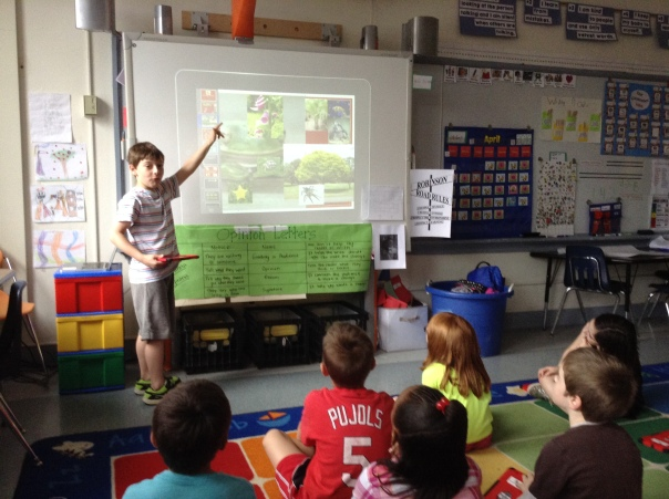 Look at Alexander teaching the class about how he sorted the pictures.