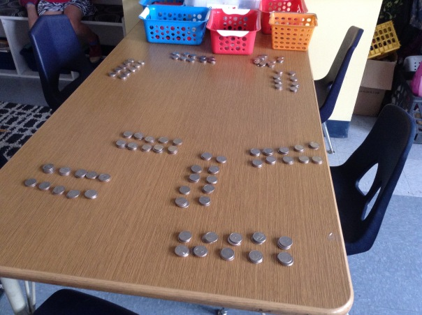 Look at all of our organized quarters in groups of $10 each.  Awesome team!