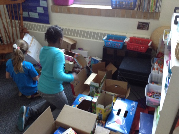 Look at Leanna working hard to sort our boxes.