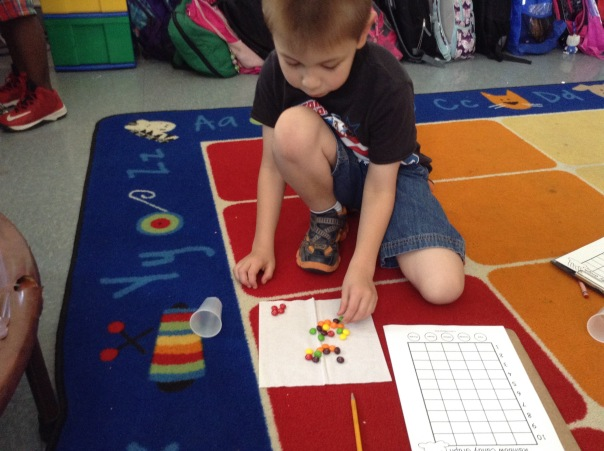 Thomas worked to sort his Skittles.