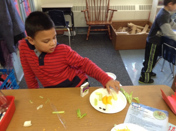 Sanjar worked to create his math snack with shapes.