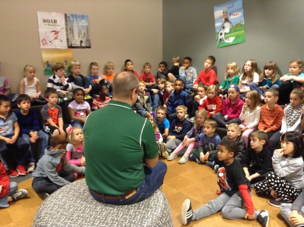 Author, Tom Johnston, read his book Lucky the Reindeer to the entire first grade.