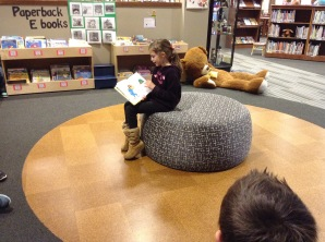Bella read to our whole class in the library.