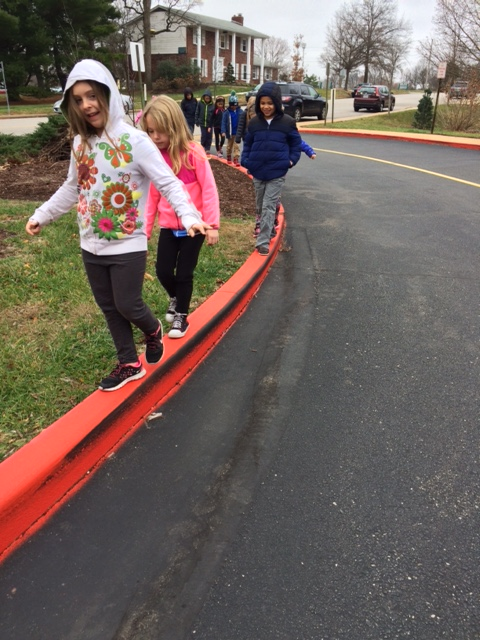 Here are some happy first graders taking a morning walk in front of our school.