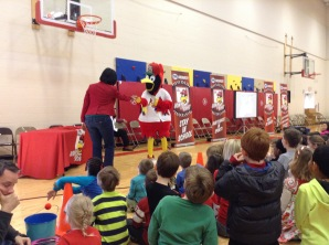 Fredbird was asking a teacher to dance at our assembly!