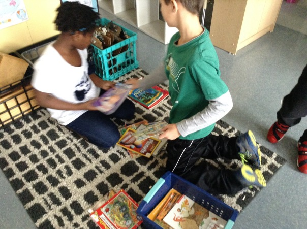 Paiton and Isaiah worked to sort fiction and non-fiction books.