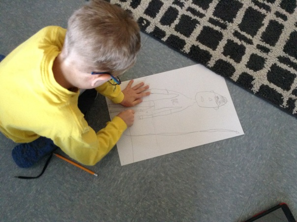 Gus worked to draw a portrait of what he dreams to be when he grows up.