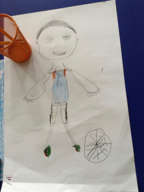 Here is one of our ALMOST finished portraits of what one of our first graders wants to be when he grows up - a basketball player!