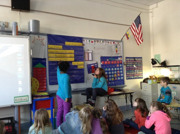 Paiton and Jamie work together to teach one another during our morning message.