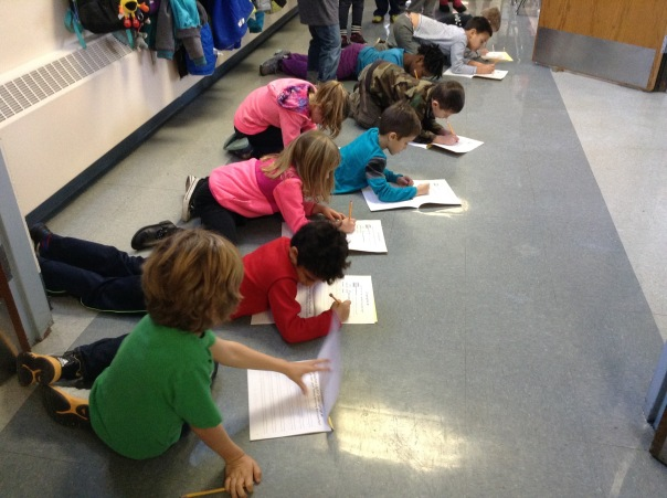 "These first grade scientists are recording sounds they heard during a ""sound hunt."""