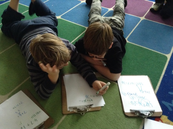 Wyatt and Gage teach one another their strategies for an addition problem.