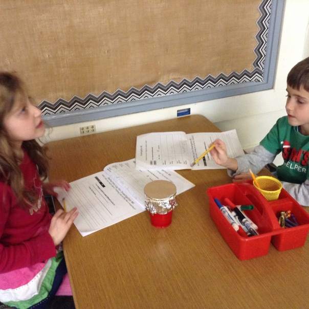 "Ruby and Riley discuss what they are learning about sound as they explore a ""drum"" made with aluminum foil."