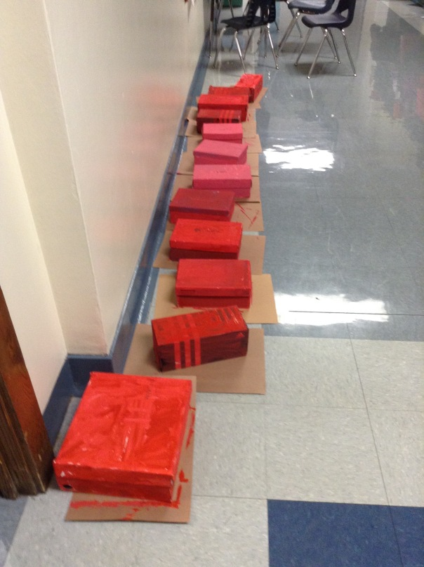 After painting our Valentine's Boxes, we had to put them in the hallway to dry.