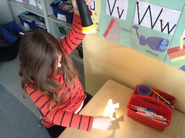 Jamie explored light with a flashlight.