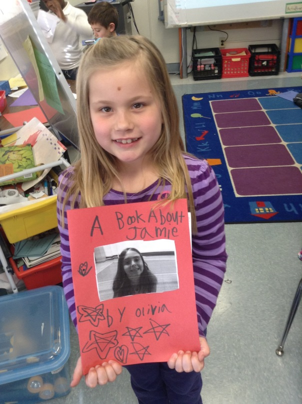 Olivia shows the book she wrote about her friend, Jamie.