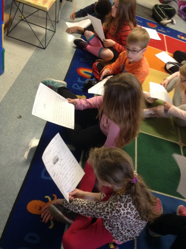 First grade writers read over their pieces to see what they could add to their writing to make it better.