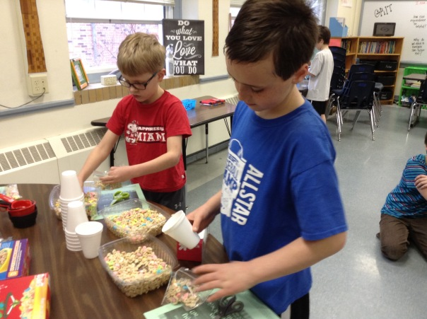 Alec and his buddy scooped out some Lucky Charms to make their snack.