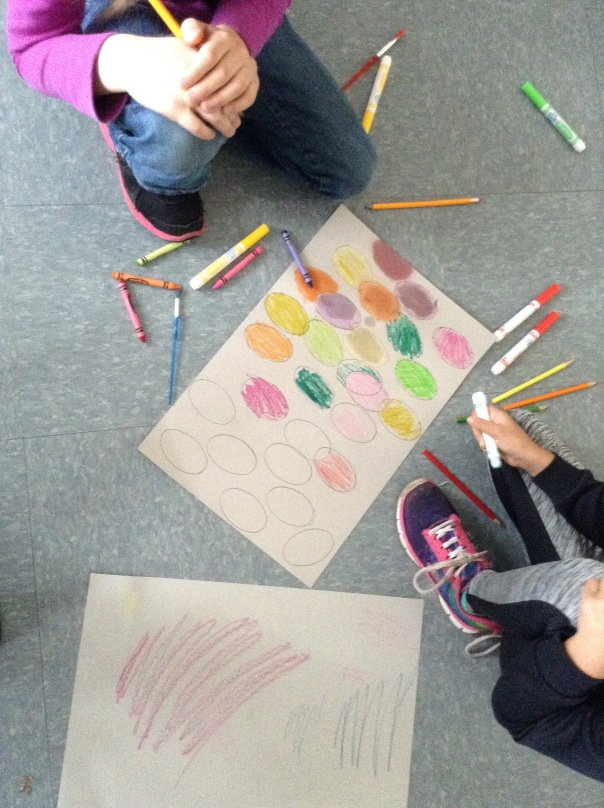 Two first grade artists worked hard one morning to create a piece of art with mixed media. Lovely!
