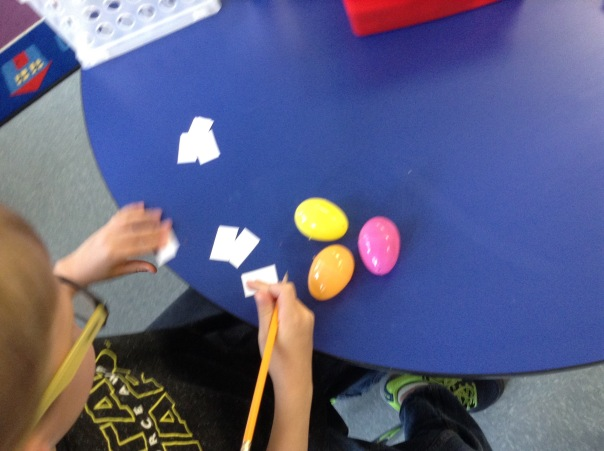 Alec worked with letters to make a word.