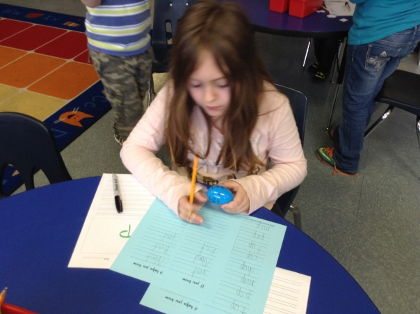 Jamie wrote down word family words from her egg.