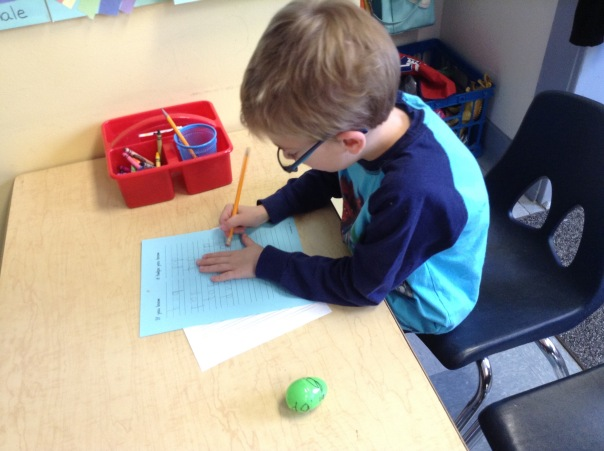 Gus wrote down word family words from his egg.
